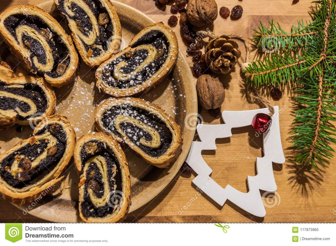 sliced poppy seed roll and christmas ornaments stock image image