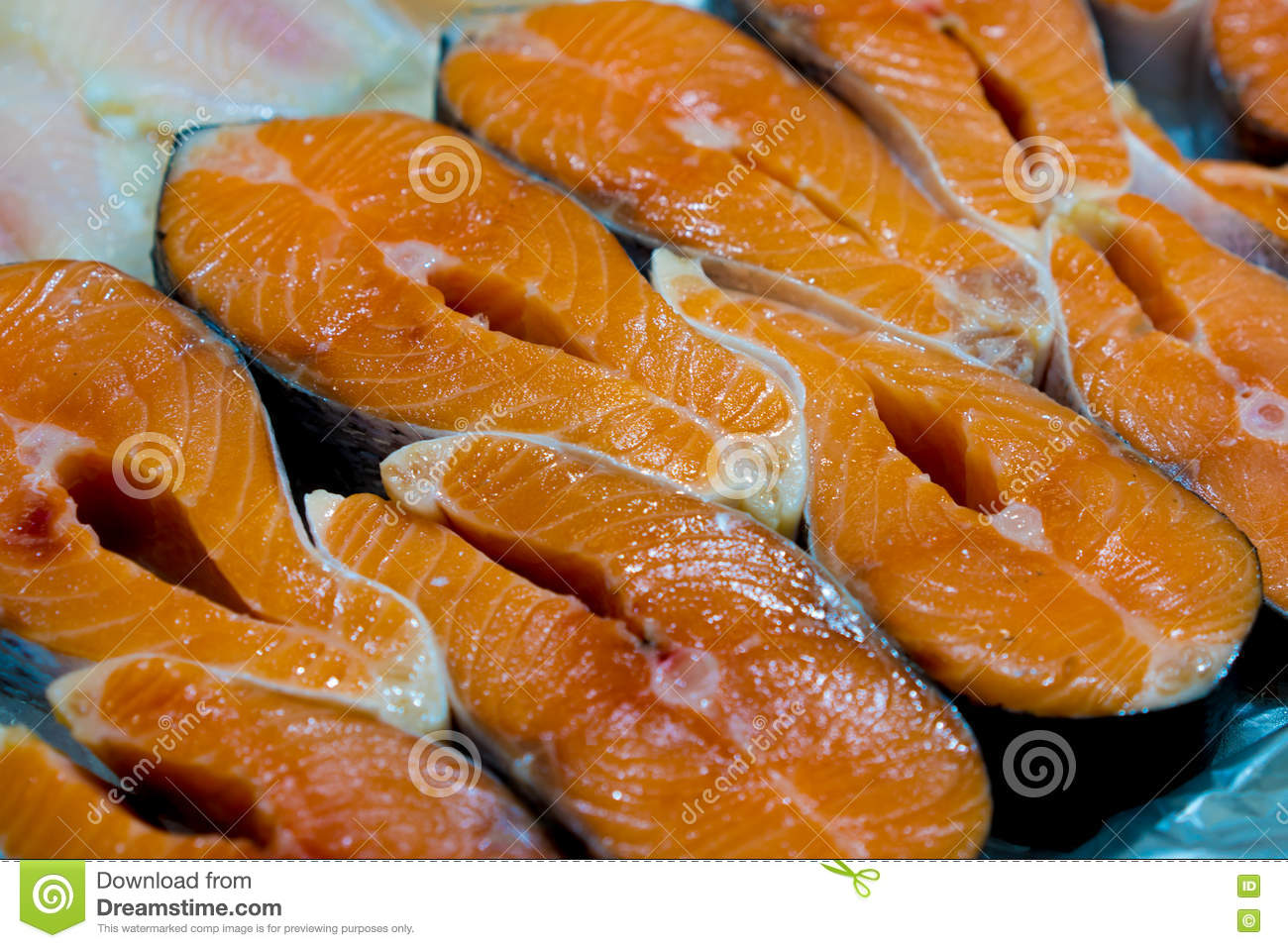 Sliced Raw Not Cooked Salmon Red Fish Lying In The Ice On The