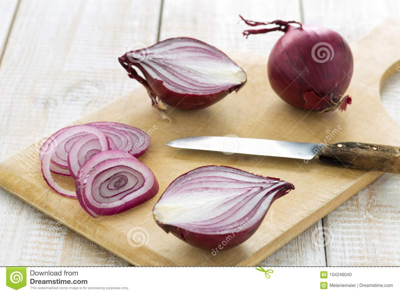 Sliced Red Onions On A Cutting Board With A Knife Stock