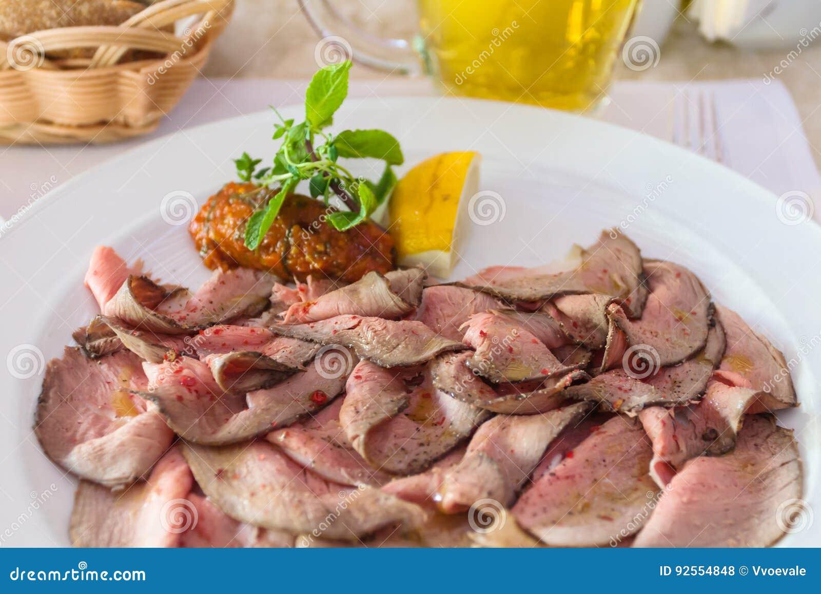 Sliced roast beef package - Sliced Roast Beef Close Up On Plate