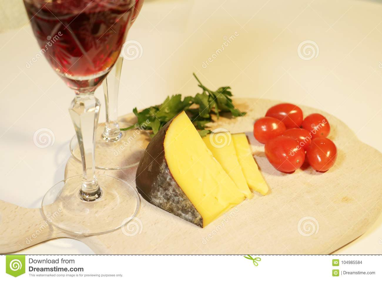 Sliced yellow cheese and small red tomatoes