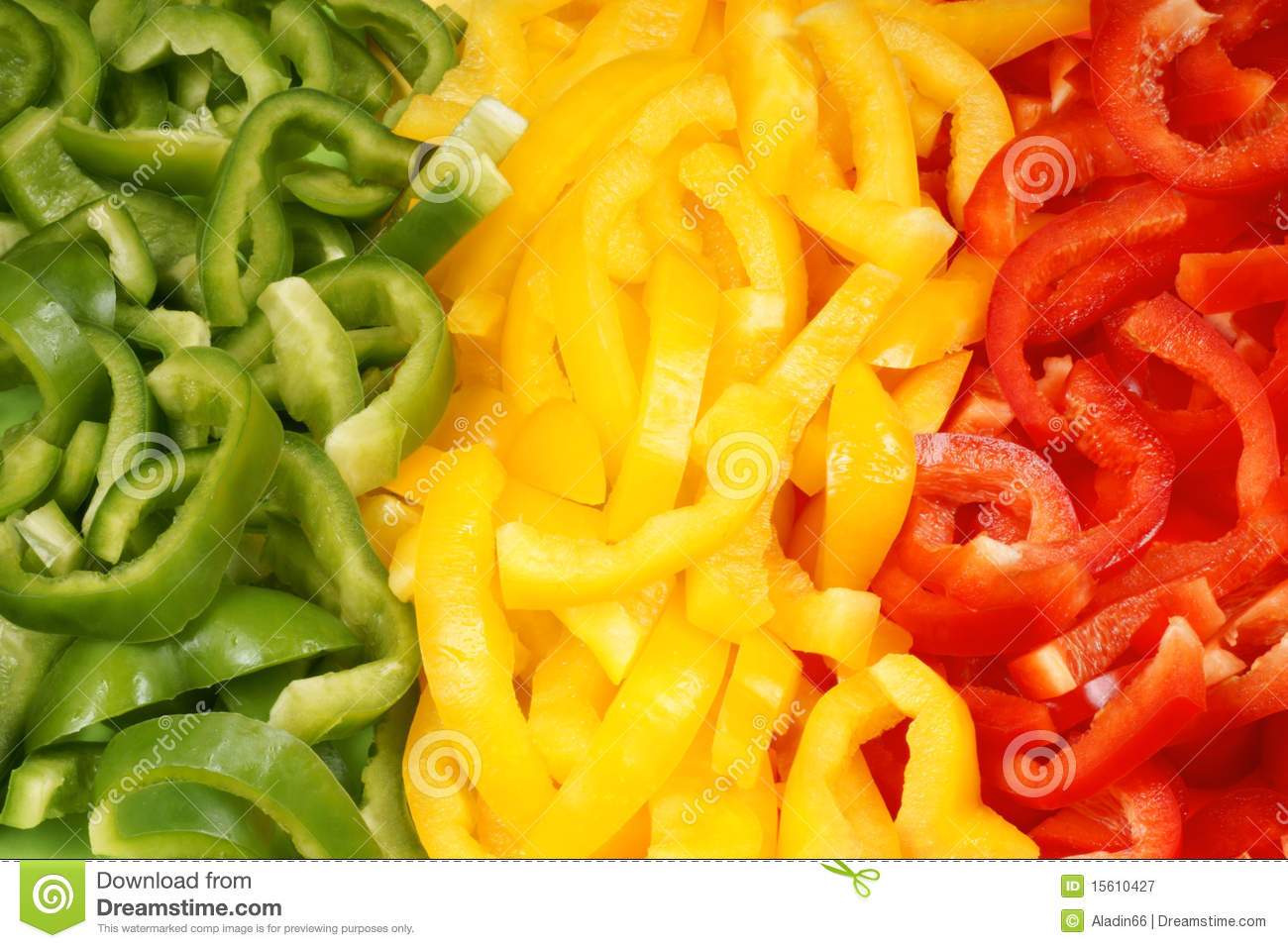 Slices of green, yellow and red bell pepper
