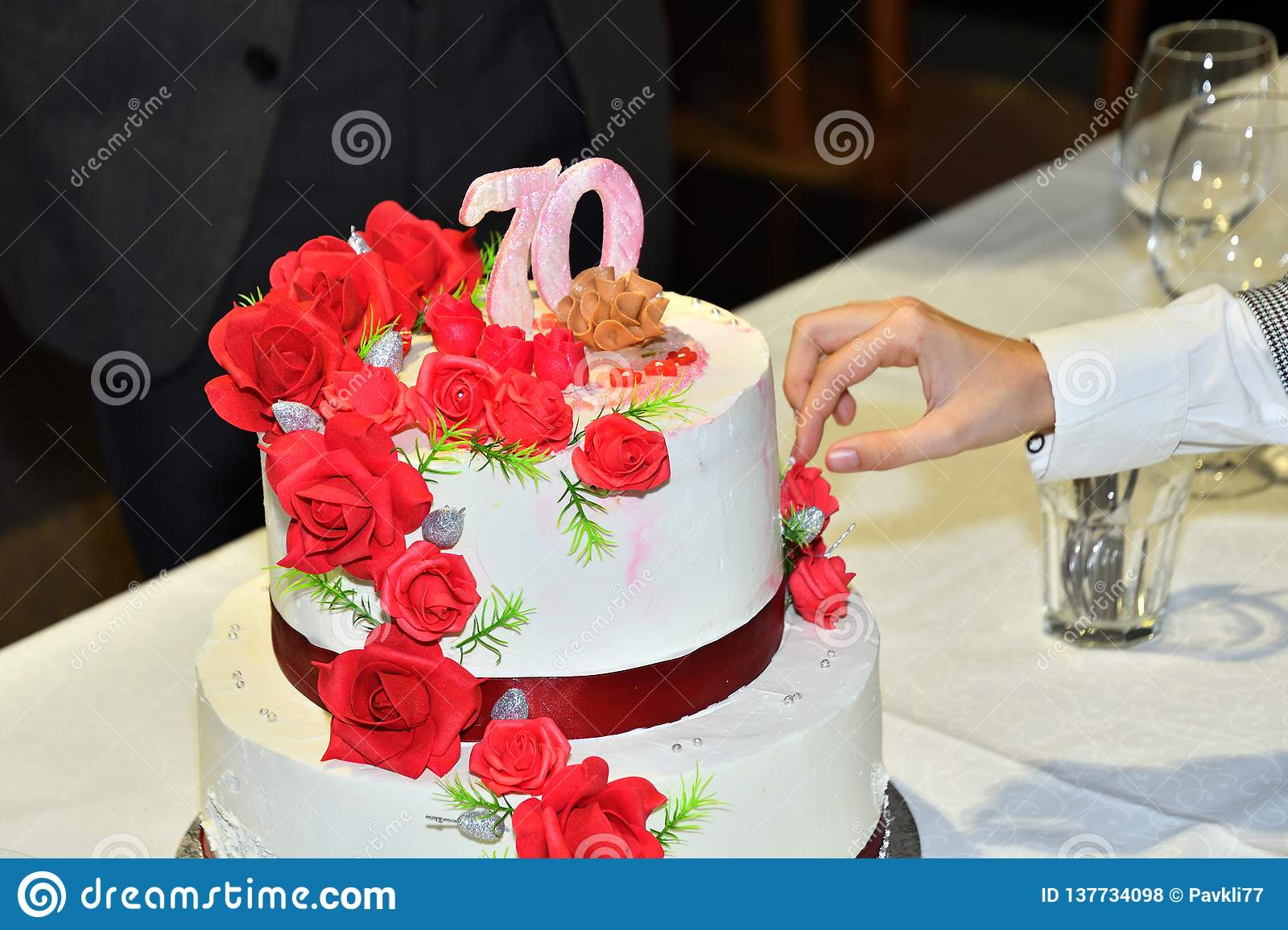 Miraculous Slicing Cakes With A Knife To Celebrate 70 Birthdays Stock Photo Funny Birthday Cards Online Elaedamsfinfo