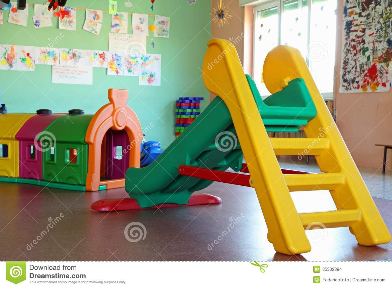 Slide And Plastic Tunnel In The Playroom Of A Preschool Stock Images - Image: 35302884