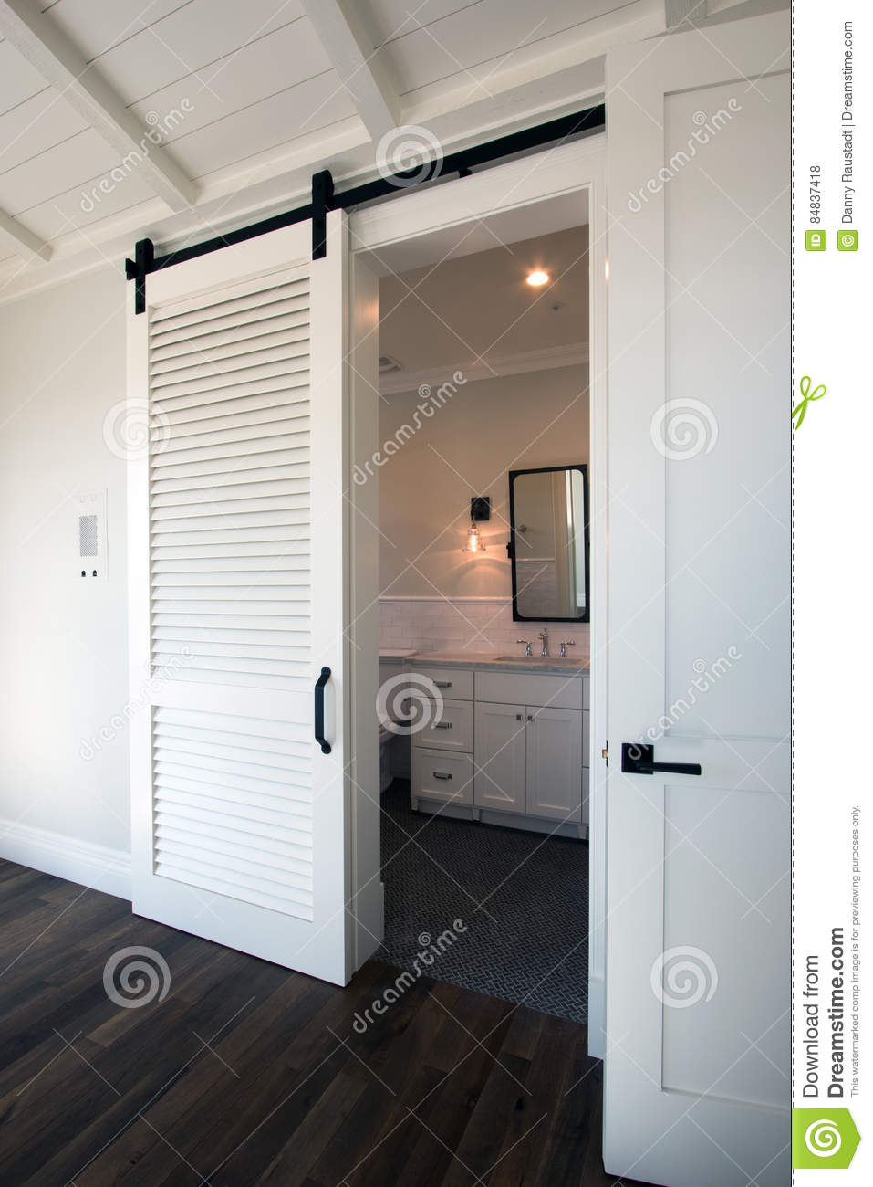 Interior Sliding Barn Doors Into Bathroom Stock Photo
