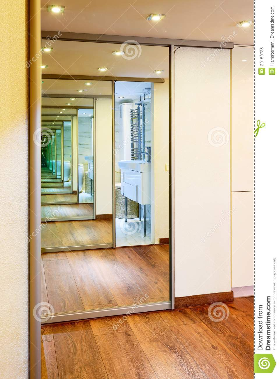 Sliding Door Mirror Wardrobe In Modern Hall Interior Stock