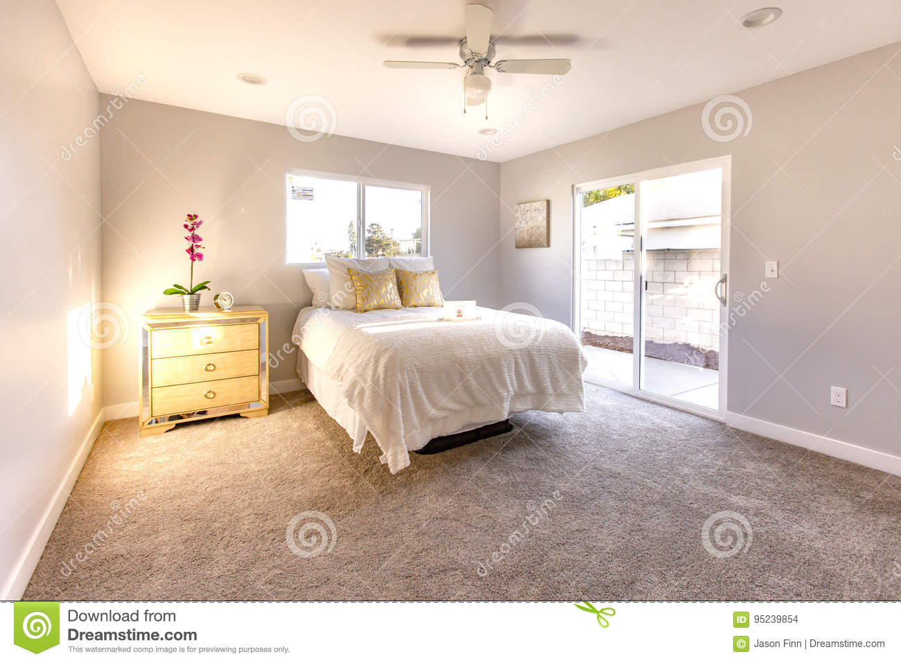 Sliding Glass Door Allows Warm Light To Flood This Master Bedroom In San Diego Model Home Stock Photo Image Of Door Cozy 95239854