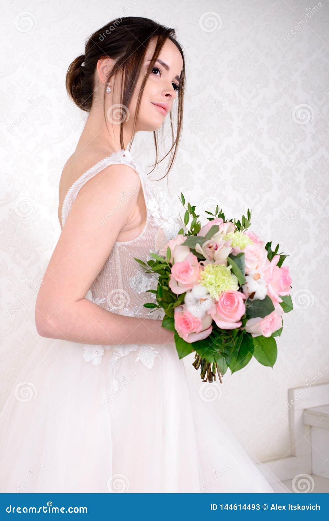 Slim Beautiful Woman Wearing Luxurious Wedding Dress Over