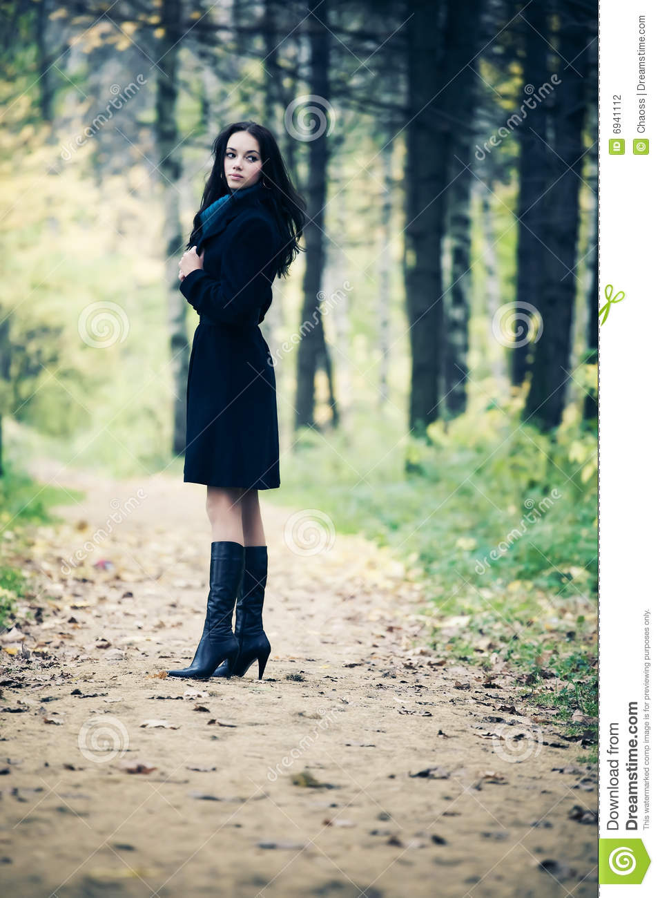 Slim Brunette Woman Walking In A Park Stock Photography - Image 6941112-5025