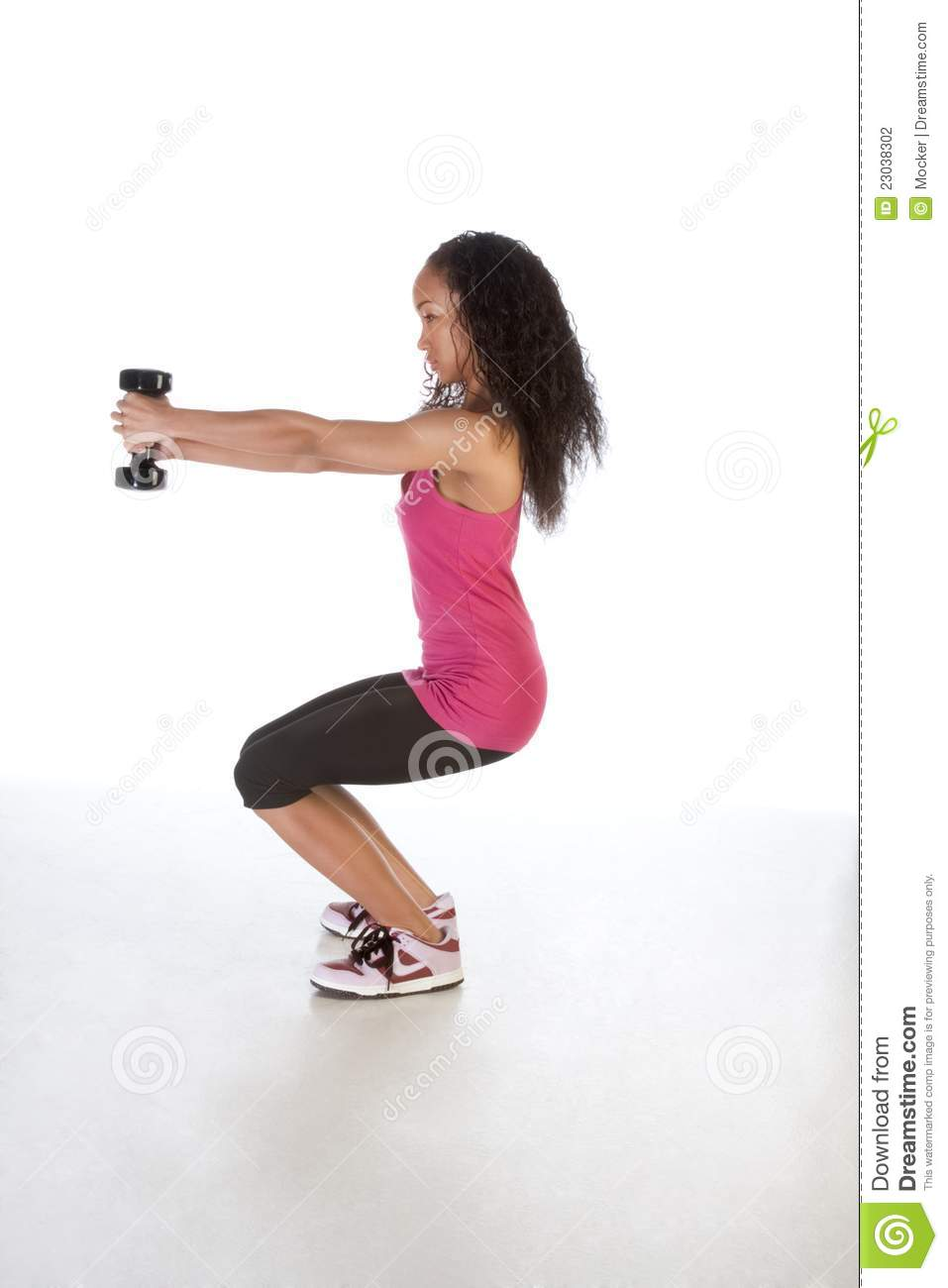 Slim Ethnic Woman Working Out With Black Dumbbell Stock