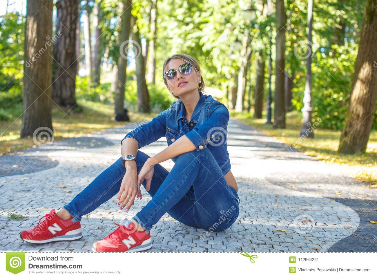 Slim Girl In Jeans Clothing And Red