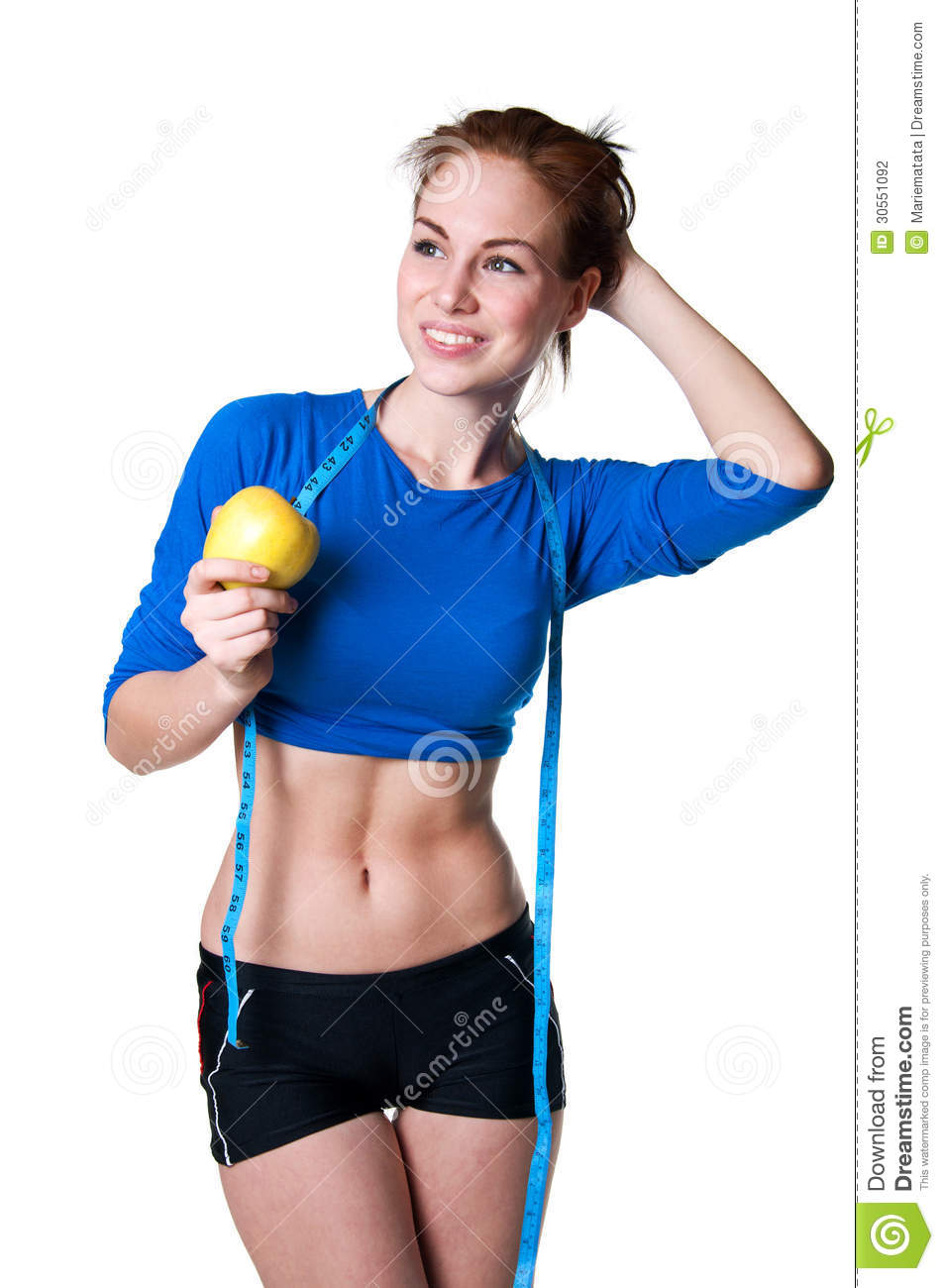 woman model wearing blue top and black shorts, holding ripe apple ...