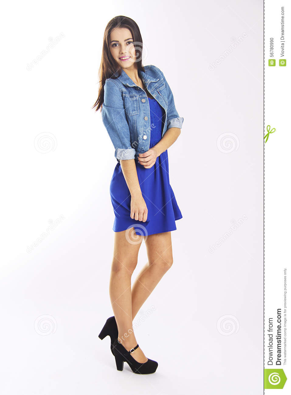 Slim student girl in blue casual dress