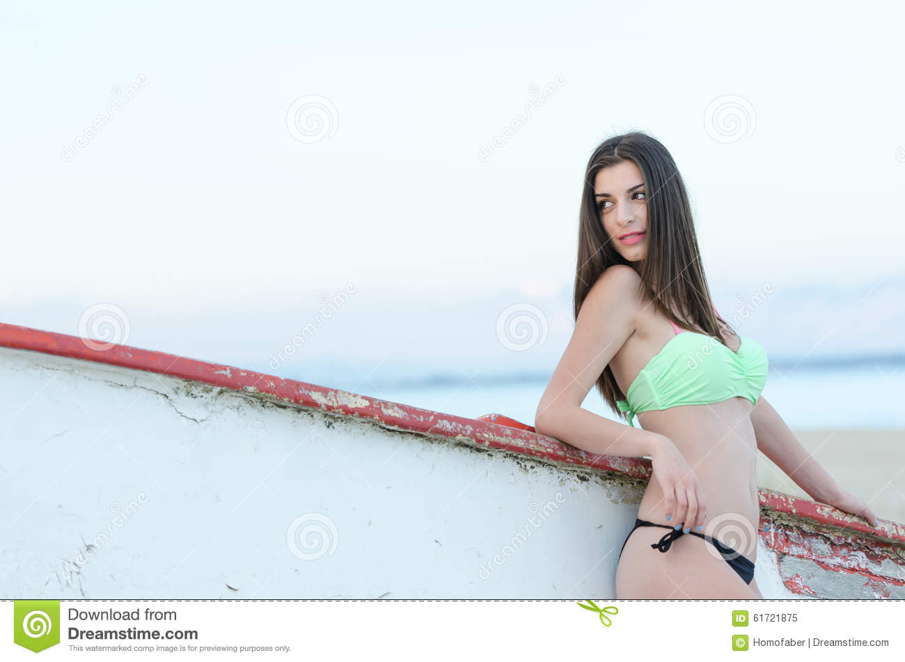 Slim Woman In Swimsuit Leaning On A Wooden Boat Stock Photo - Image: 61721875
