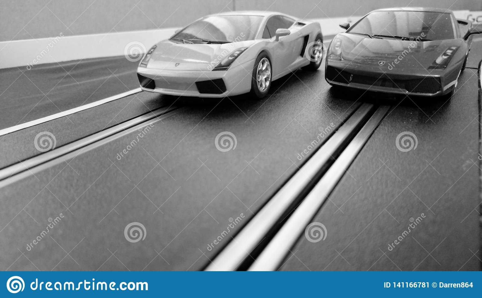 Slot cars racing on a slot car track, black and white for a retro look