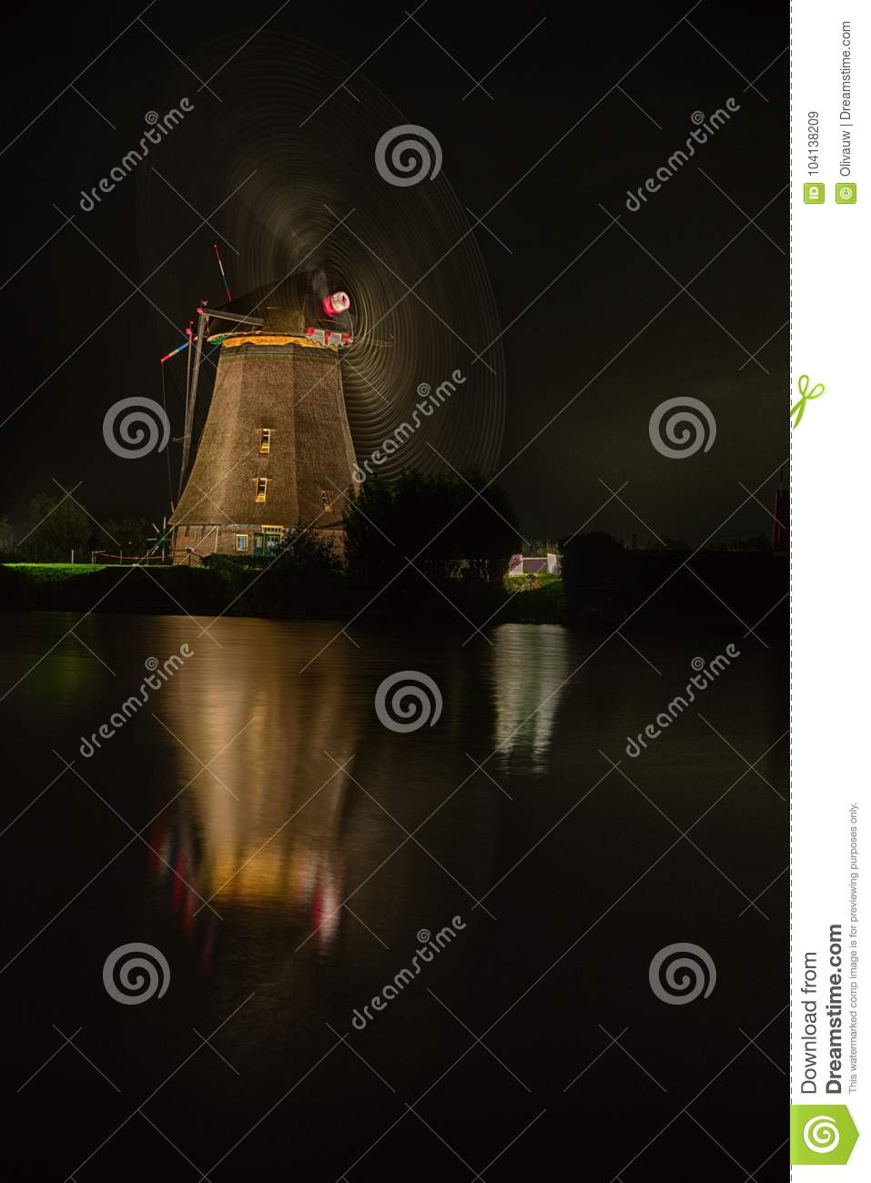 Slow Capture of a Windmill in Motion at Night