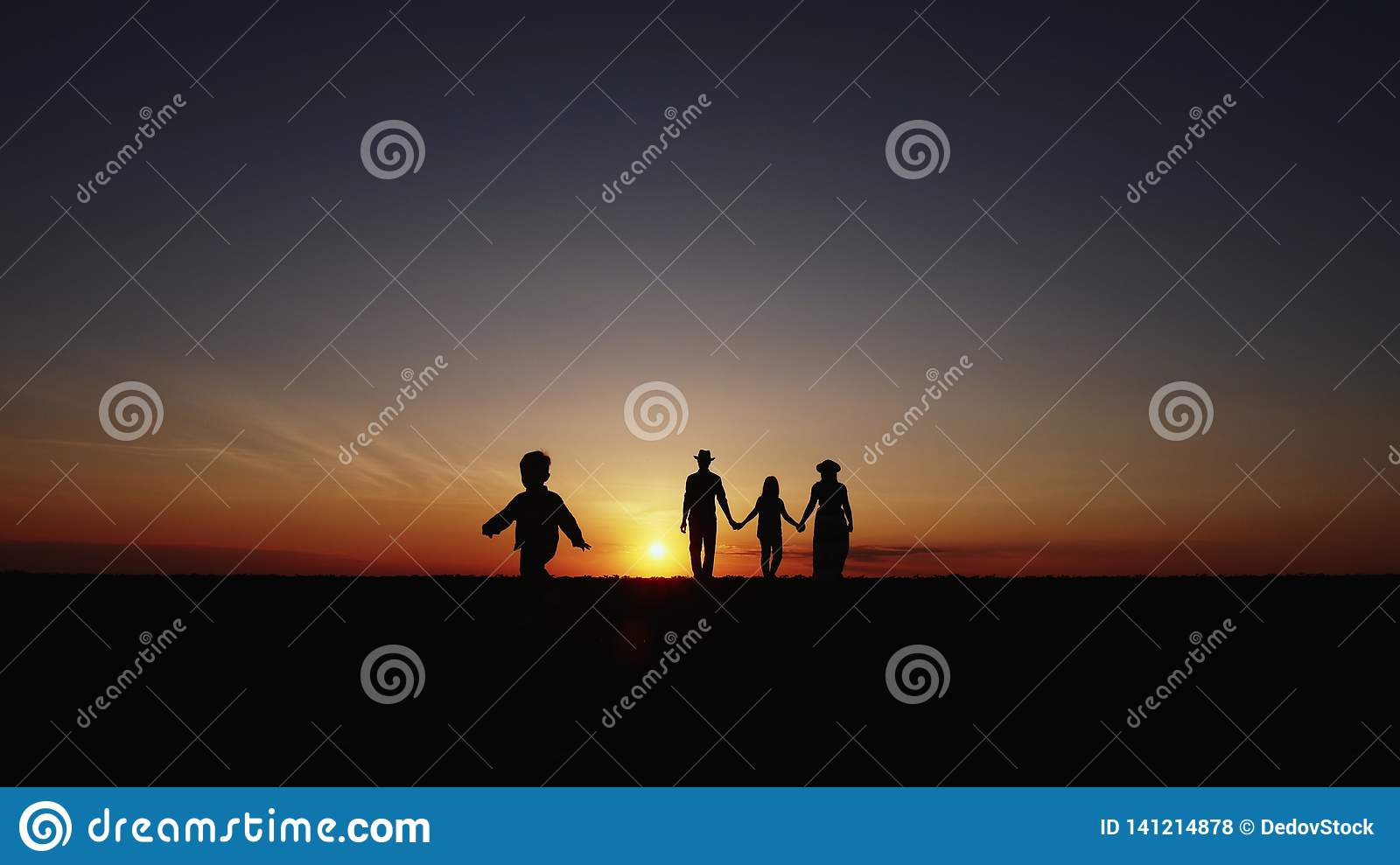 Slow Motion Silhouette at sunset happy family walking