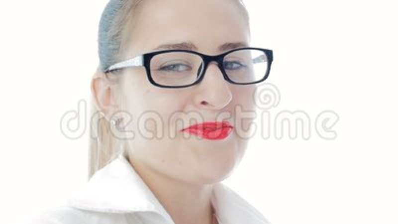 97f40c6030e Slow motion footage of elegant woman with red lipstick wearing eyeglasses.