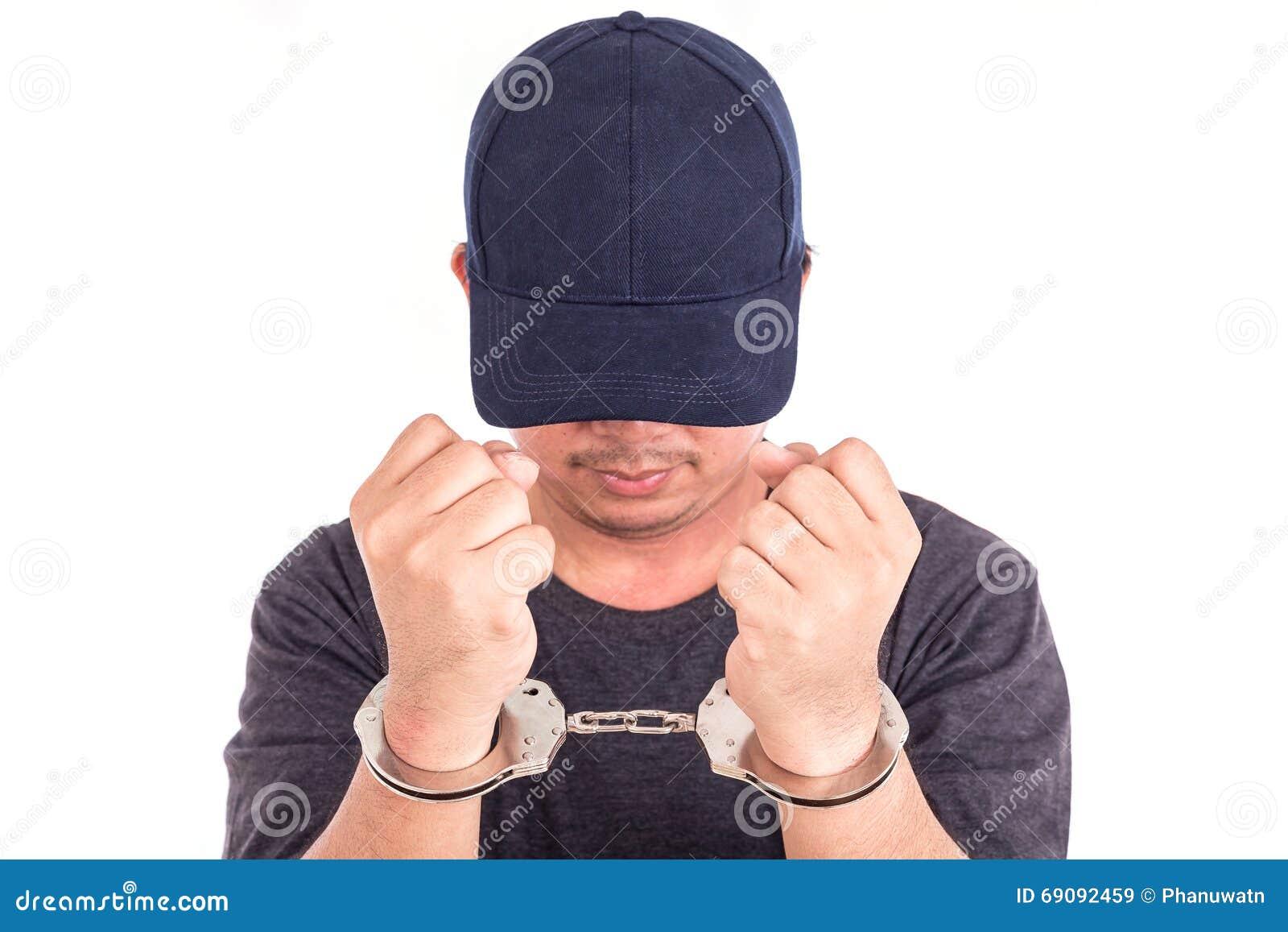 Sluit mens met handcuffs op handen op witte backgroun omhoog wordt de geïsoleerd die