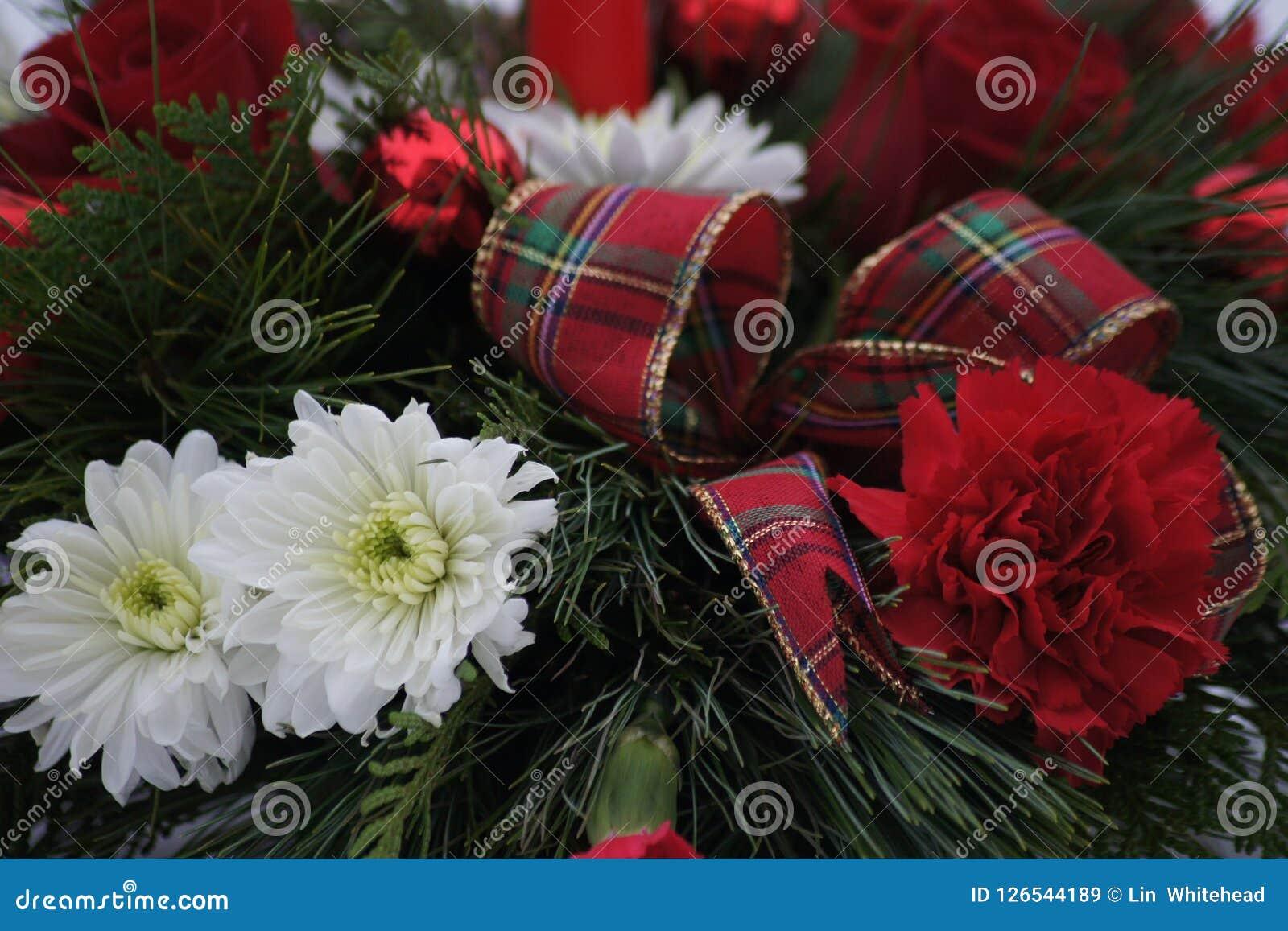 Sluit omhoog van een mooi Kerstmisbloemstuk