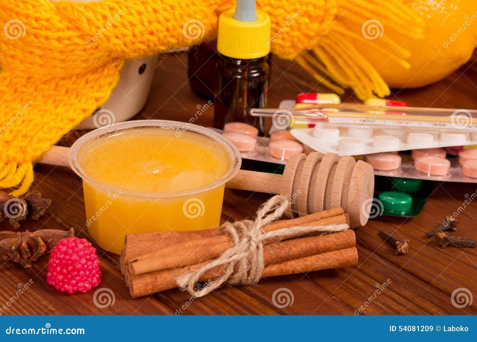 Sluit omhoog van honing en pillen