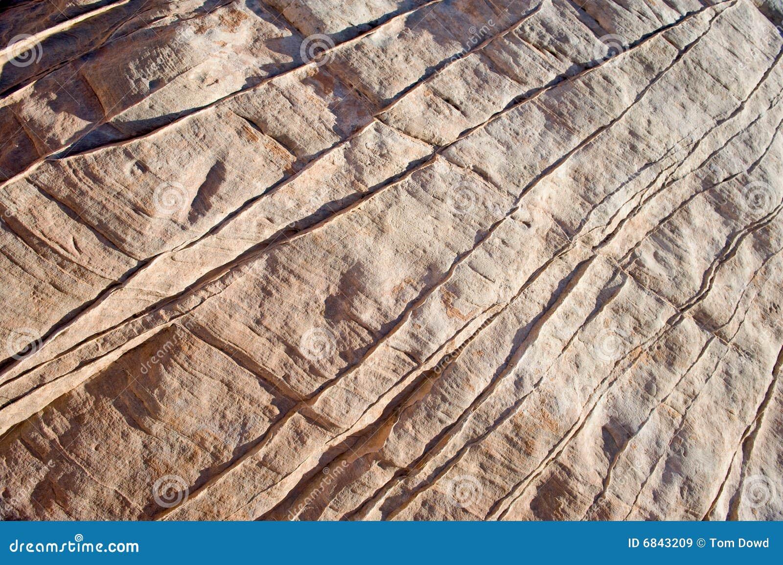Sluit omhoog van lijnen in rots