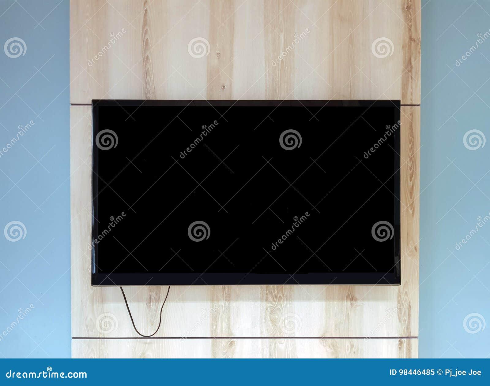 Sluit omhoog van Televisie bij het houten muur hangen boven bank in bureau