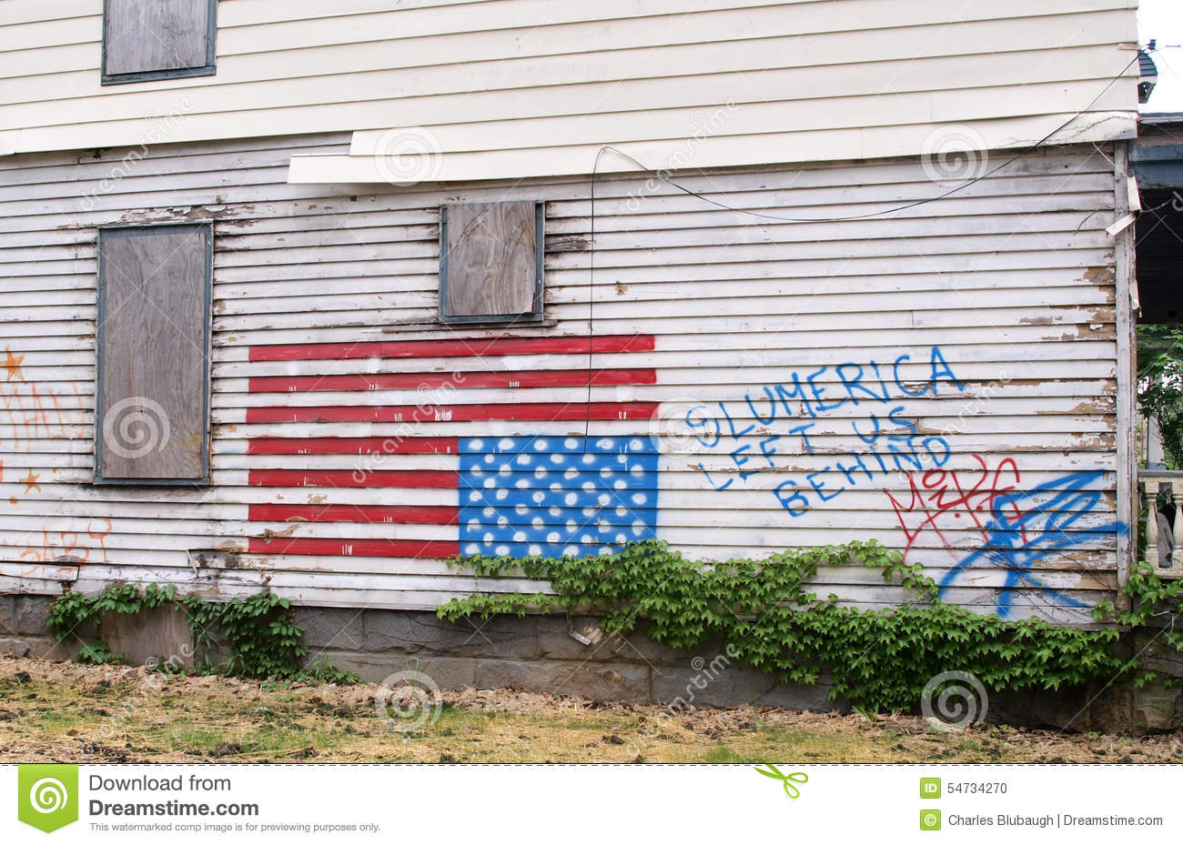A Vacant Vandalized House In The Inner City Of Cleveland Ohio With An American Flag Graffiti And Message