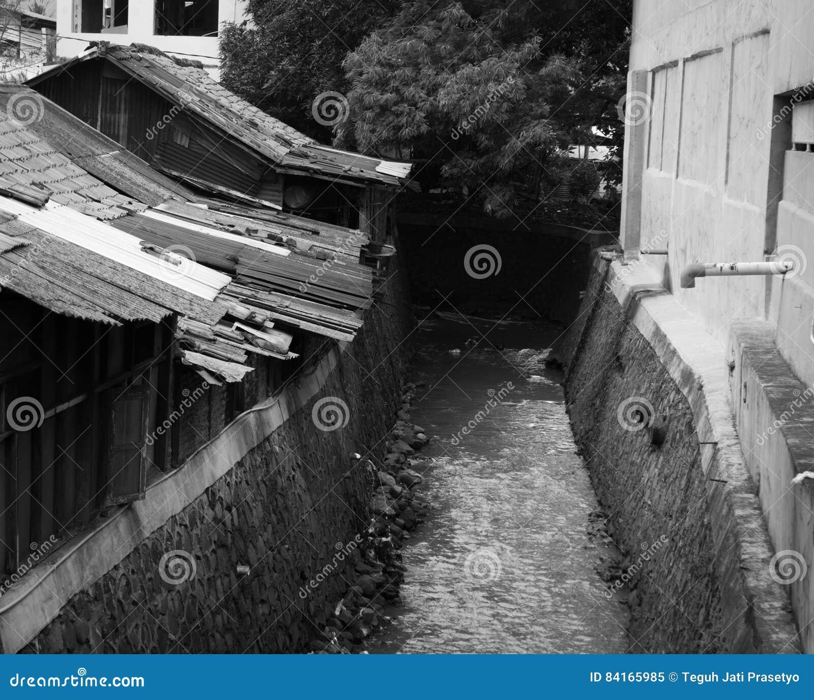 Slums Near Dirty Ditch In Black White Theme Photo Taken In