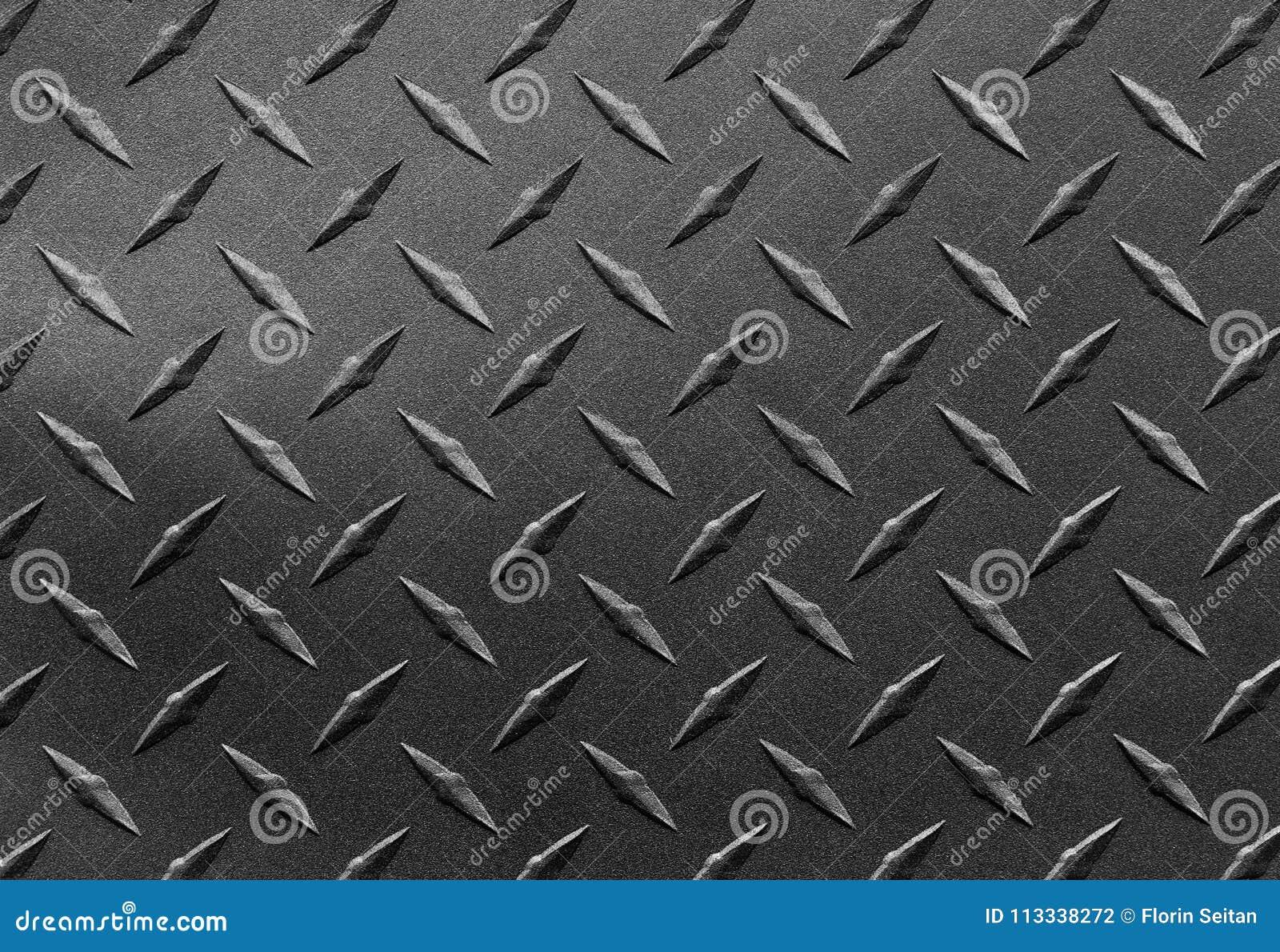 Slut upp av det korniga texturerade stålarket med diamantplattamodellen, metallisk bakgrund