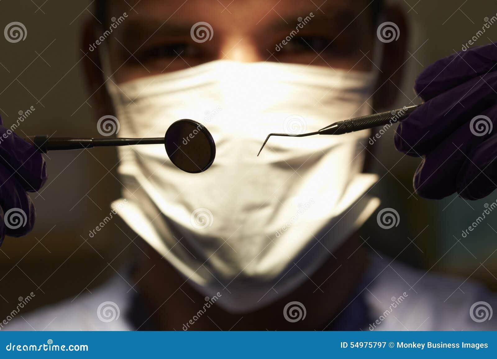 Slut upp av tandläkareHolding Dental Examination utrustning