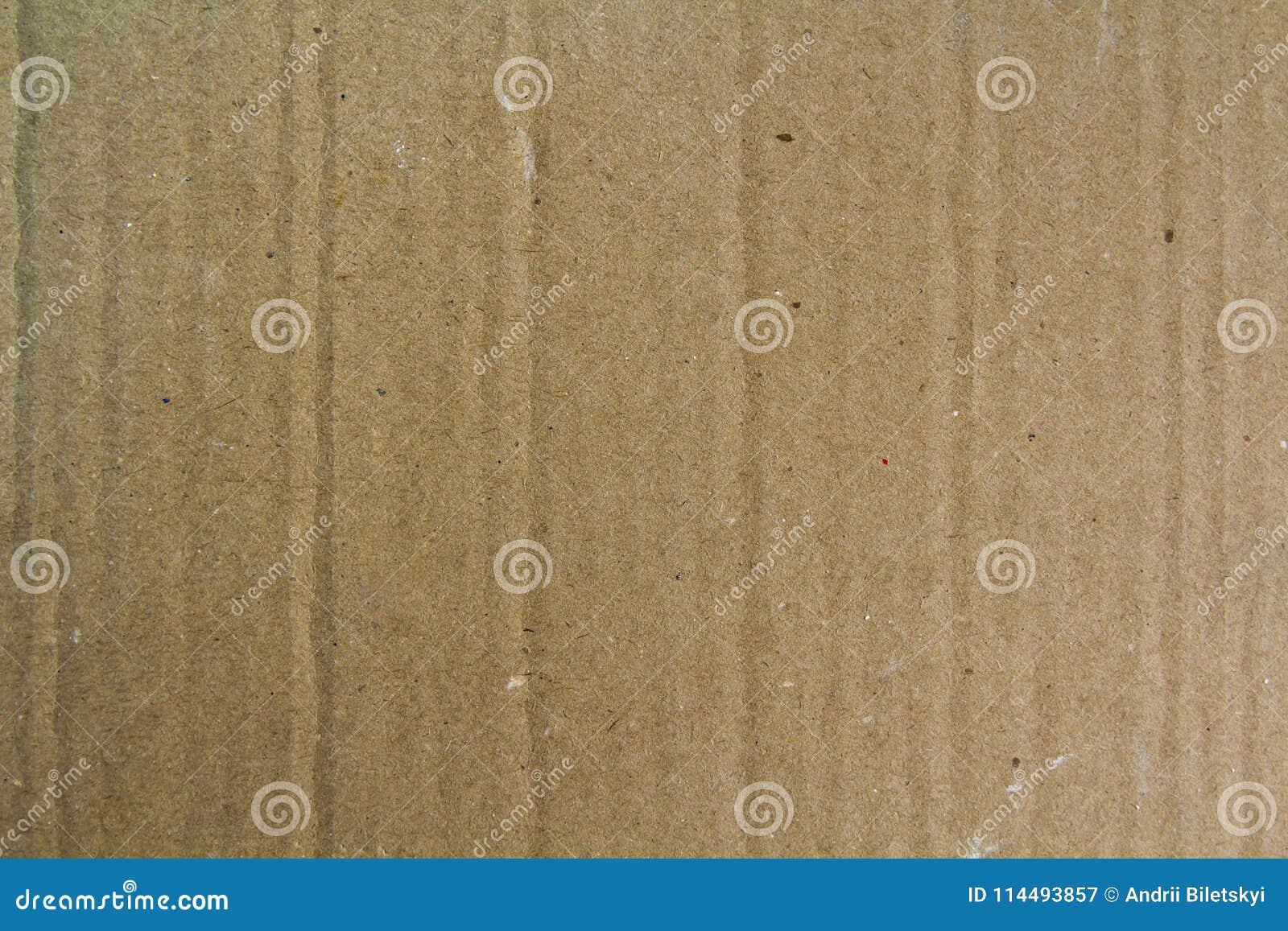 Slut upp gammalt kornigt dekorativt ljus - brunt tappningbuseark av textur eller bakgrund för lådapapppapper