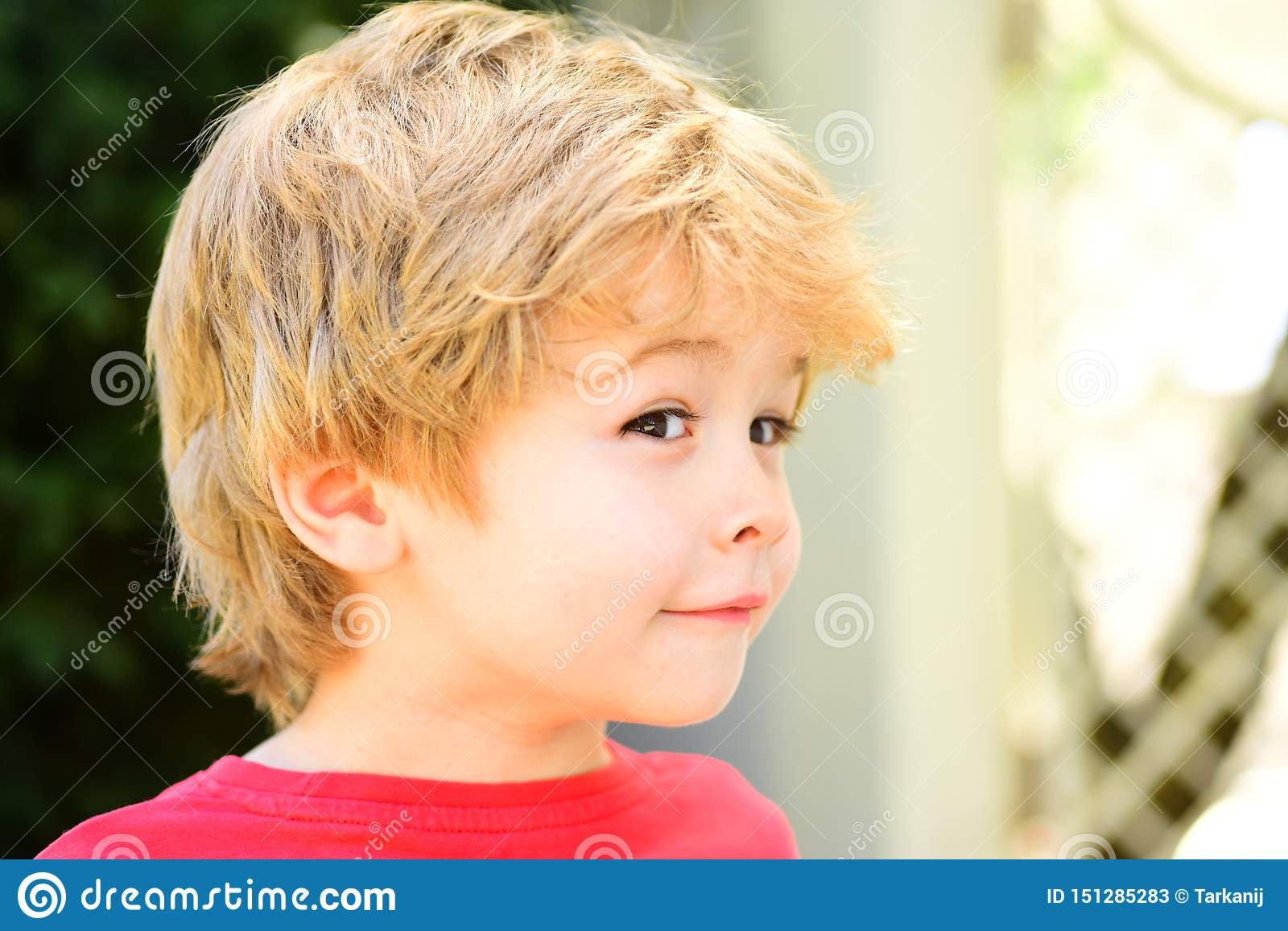 Sly Playful Baby Boy Funny Child With Cute Hairstyle Smart