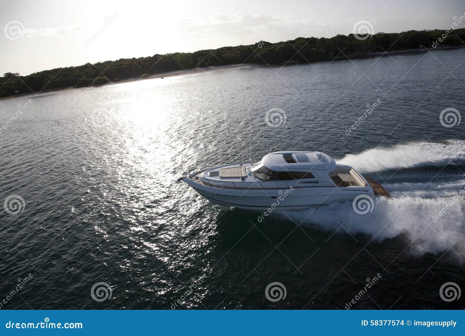 Smal Motor Boat Sailing Across The Coast Stock Photo