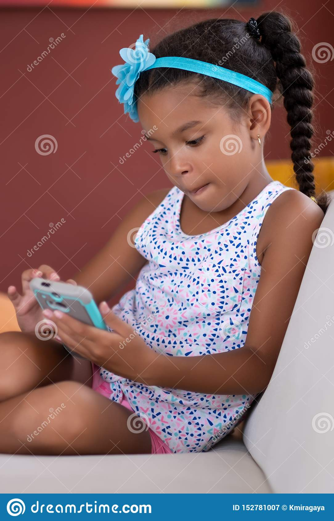 Small African American Girl Using A Mobile Phone Stock Image Image Of Ethnicity Child 152781007