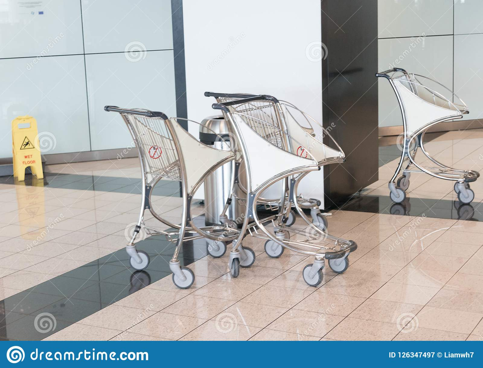 Small Airport trolley caariage many empty isolated