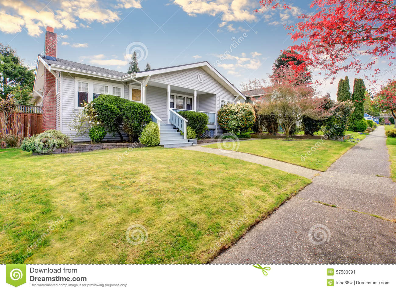 Small American Home With Light Exterior And A Large Grass