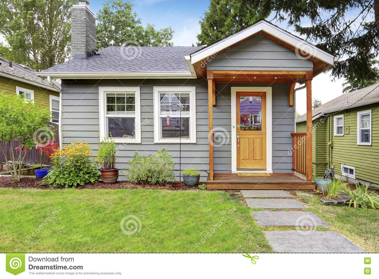 Small American House With Gray Exterior Paint Stock Photo