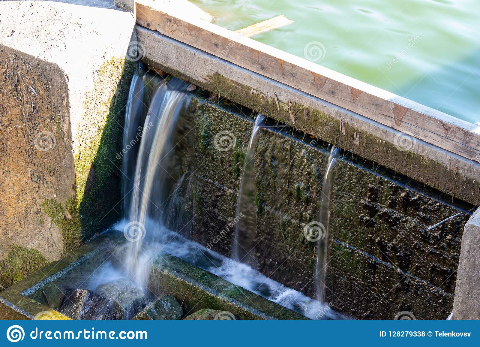 Small Artificial Waterfall Water From The Pond Pours Through The