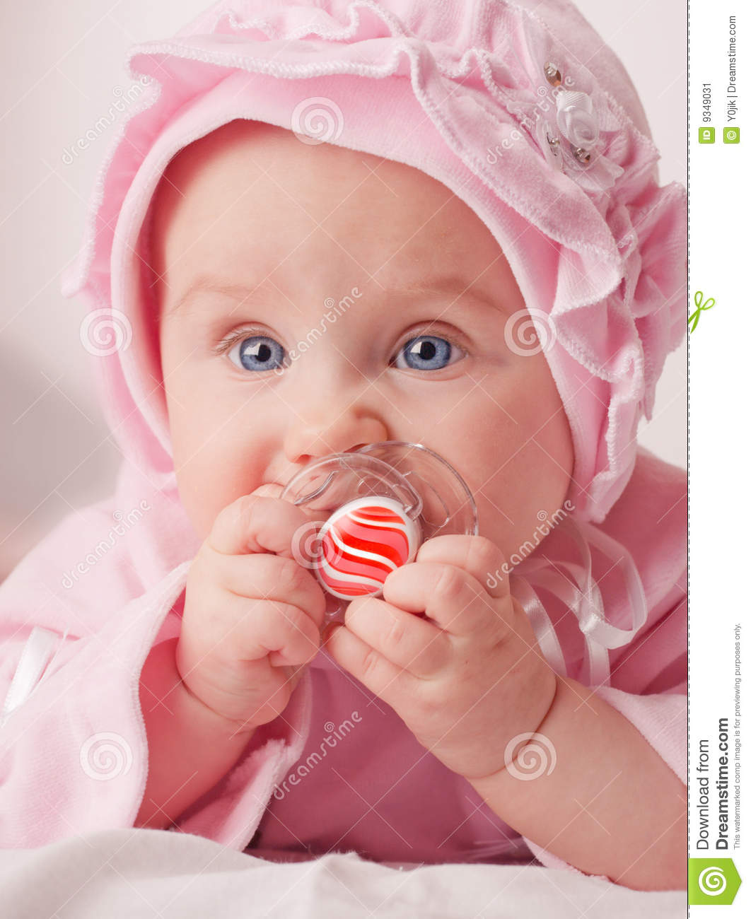 small baby with a dummy stock image. image of stare, face - 9349031
