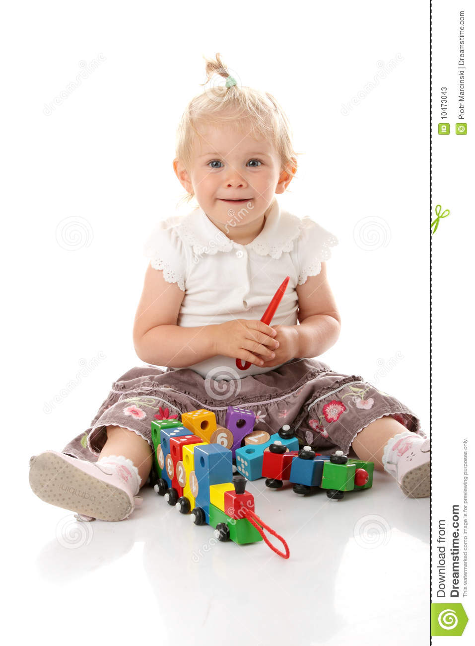 Small Baby Girl With A Toy Stock Photos Image 10473043