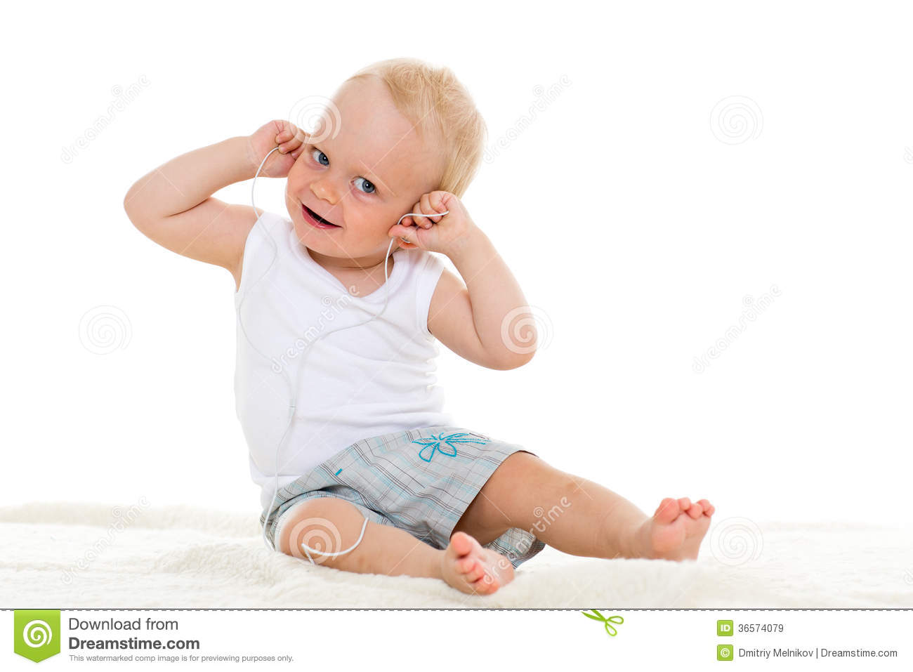 Small baby listening to music.