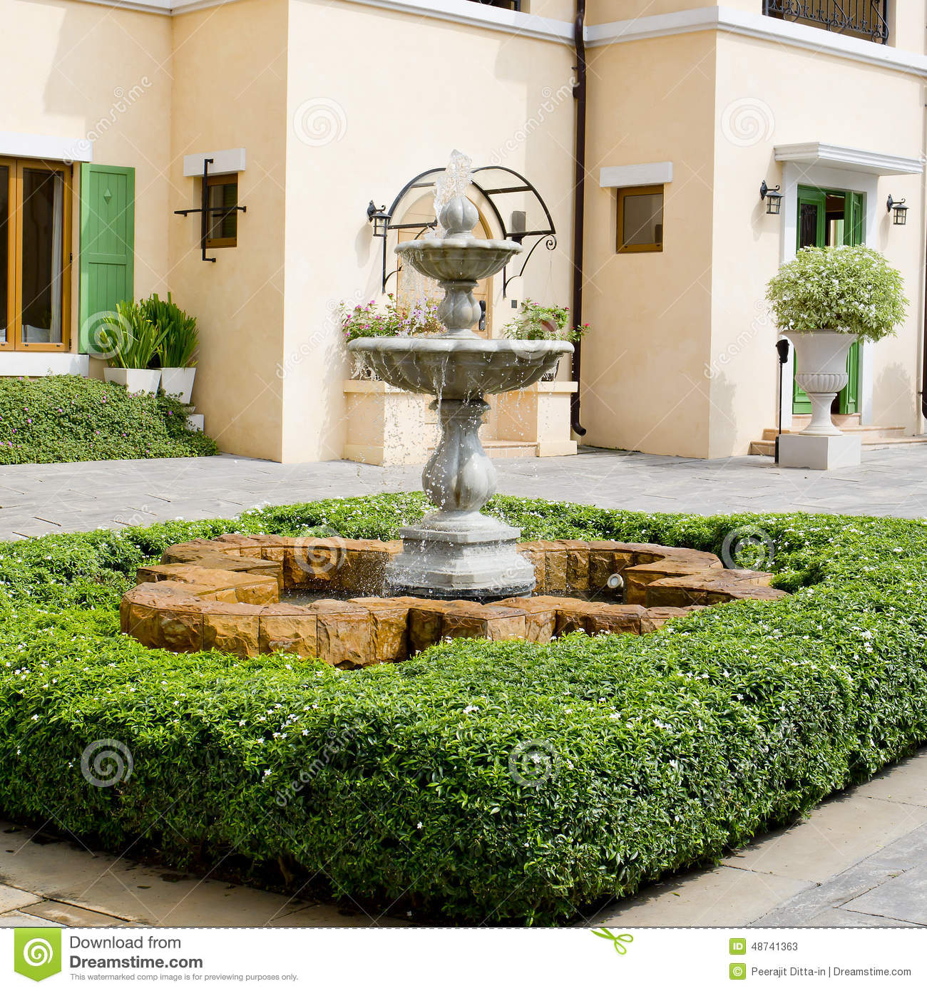 Small Backyard Fountain In A Garden Stock Photo Image