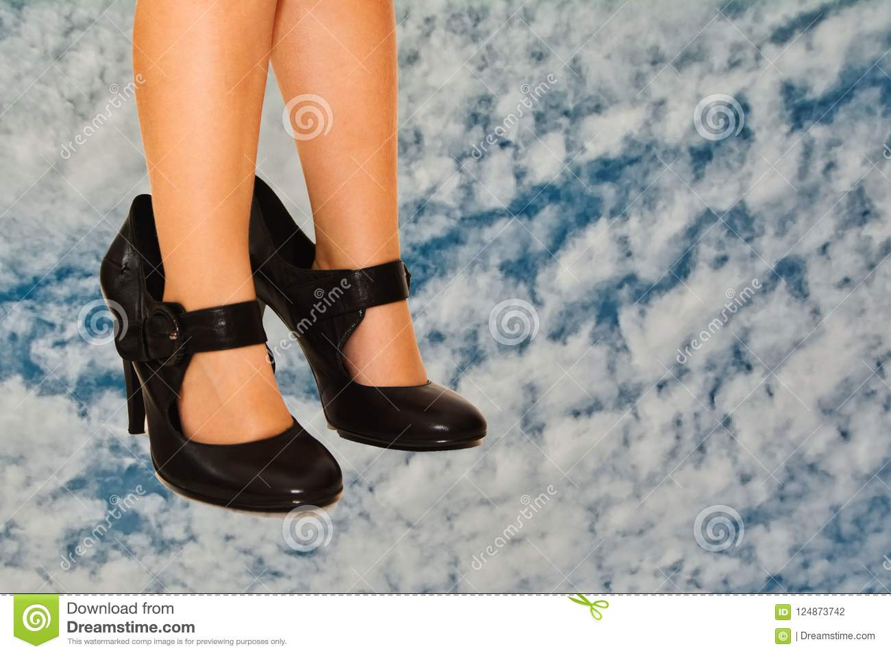 Small bare feet in big shoes