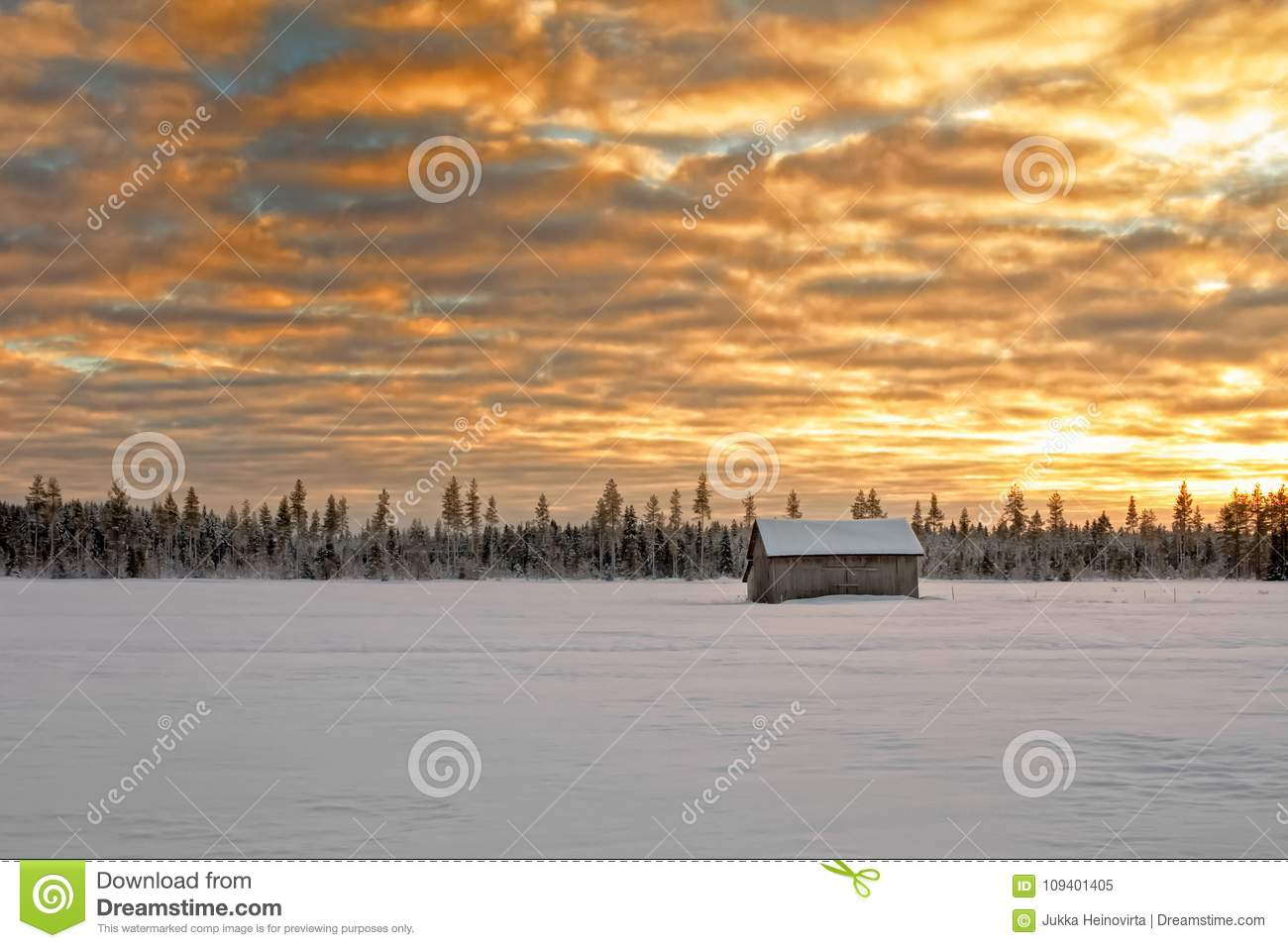 Small Barn House Covered With Snow Under The Dramatic Skies Stock