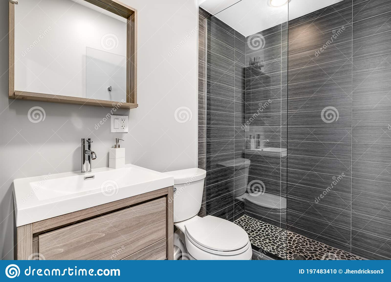 A Small Bathroom With A Light Wood Vanity And A Grey Tiled Shower Stock Photo Image Of Vanity Design 197483410