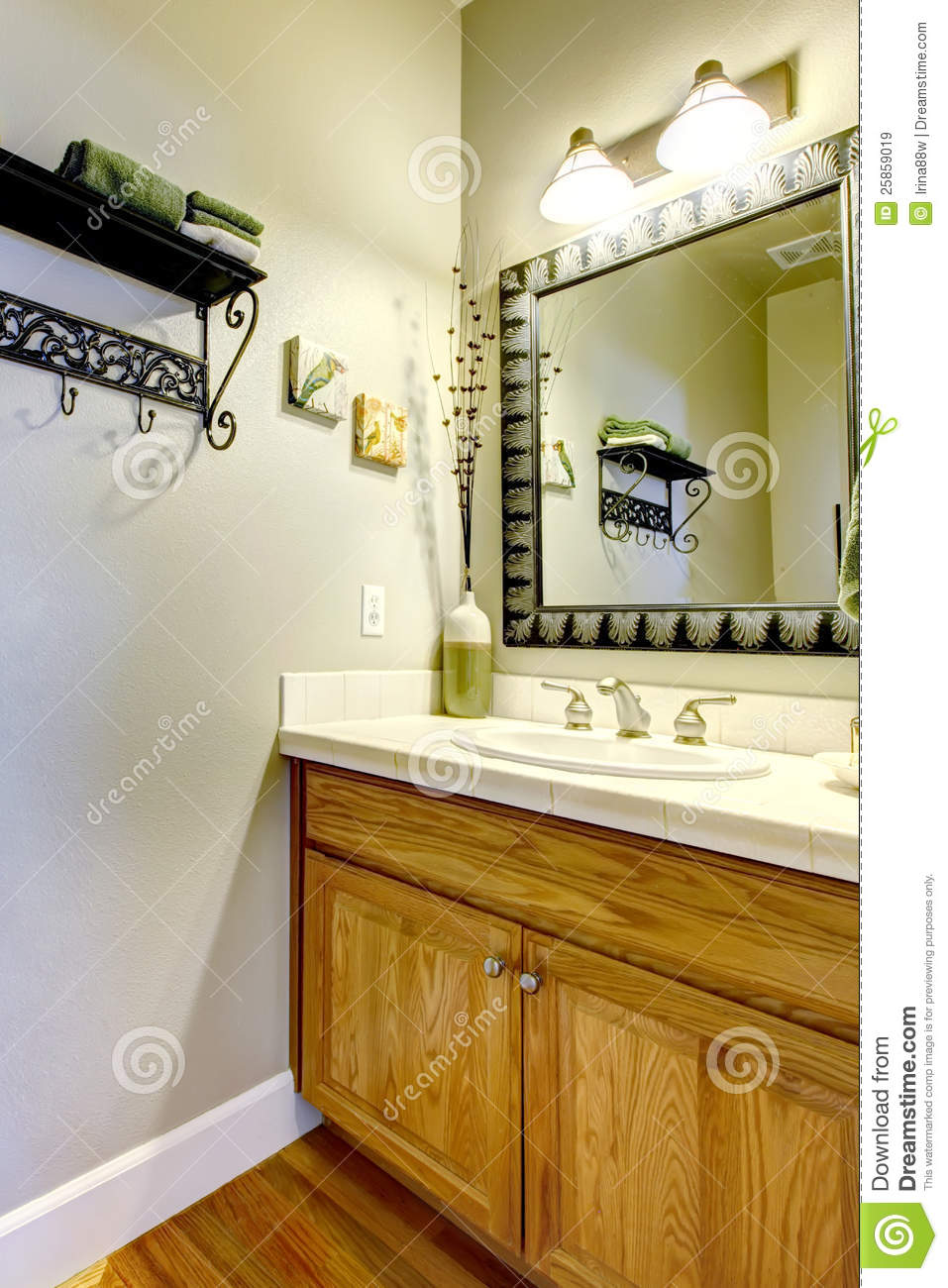 small bathroom sink and cabinet with green wall royalty free stock