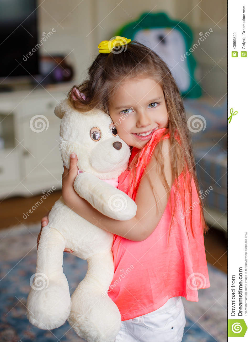 A Small Beautiful Girl Hugs Funny Bear Stock Photo Image Of Health Girls 43999590