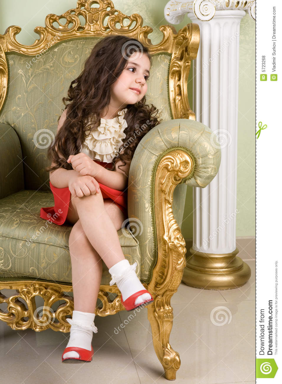 Small Beauty In A Chair Royalty Free Stock Photos Image