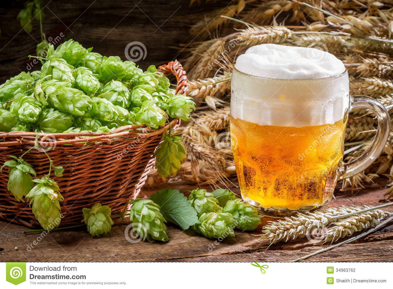 Small Beer With A Large Foam Surrounded By Hops Stock